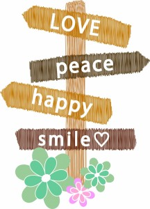 Pole with wooden signs with the words peace, happy, smile