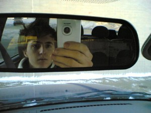 Driving will looking in rear view mirror